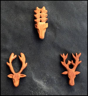 Stag head amulets