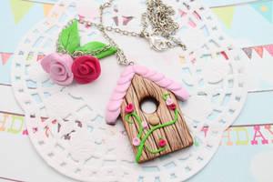 Pink birdhouse necklace by Jacarandahm