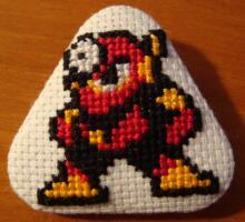 Metal Man cross stitch pin by pixel8bit