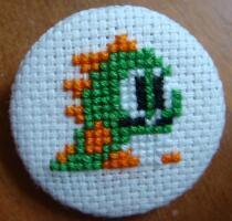 Puzzle Bobble cross stitch pin by pixel8bit