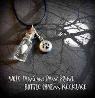 Wolf Fang and Paw Print Bottle Charm Necklace by YellerCrakka