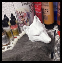 Handmade grey wolf art doll work in progress