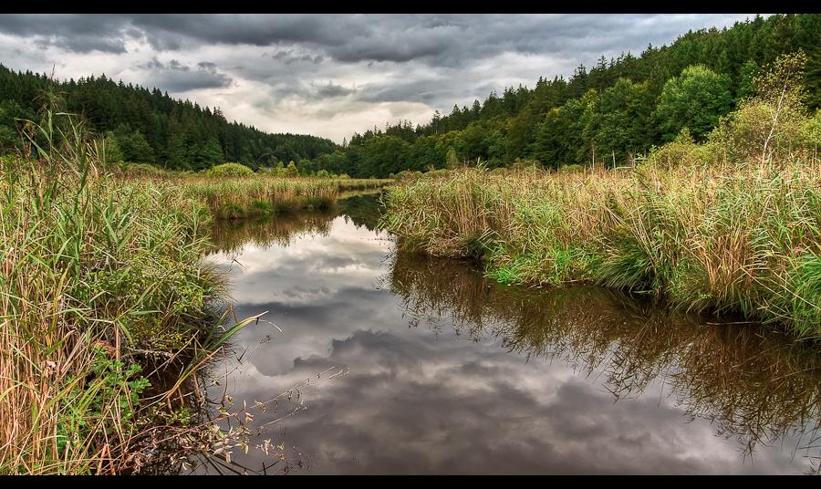 Gloomy lake by sylaan