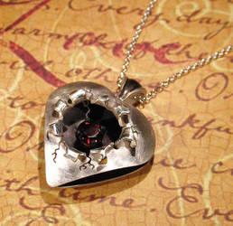 Sterling Silver Torn Heart Garnet Pendant