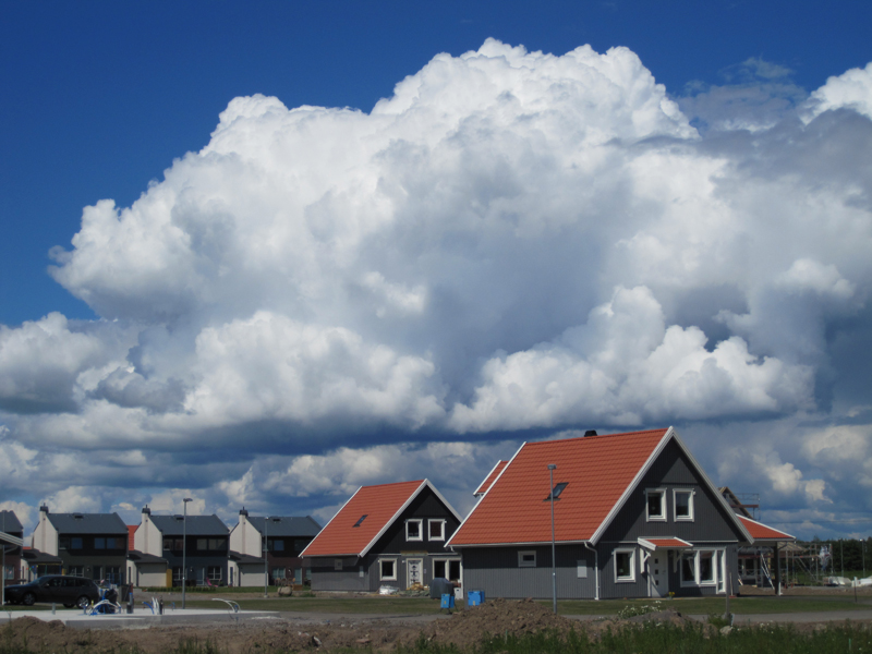 Clouds_above_houses_by_Amaunet85.jpg