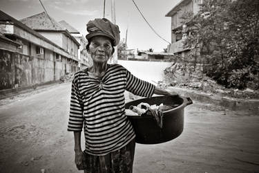 Old woman - Still working by Treke