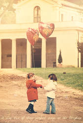 two little girls and their balloons