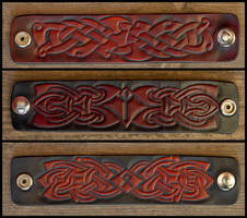 Runic and Knotwork cuffs by Wodenswolf
