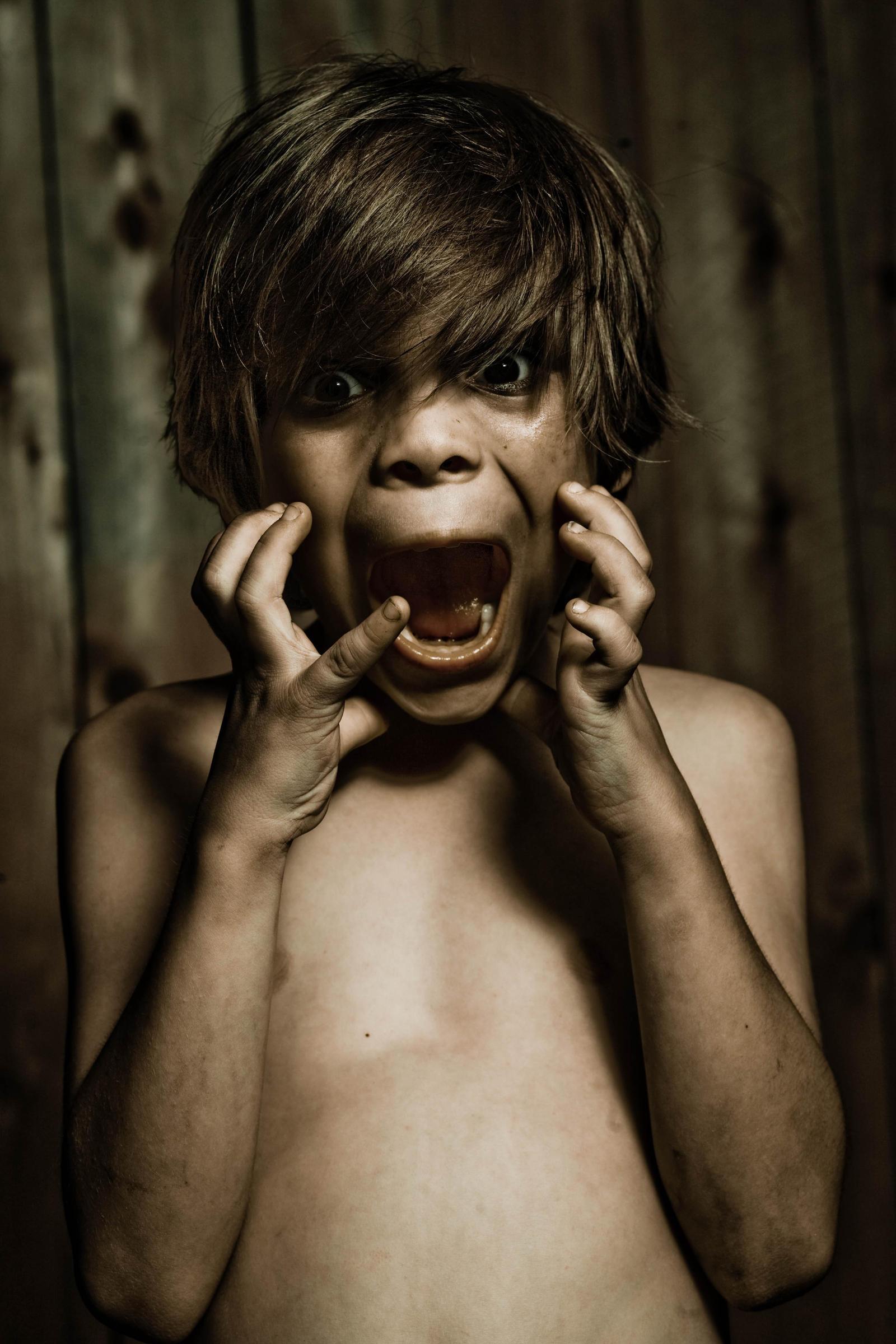 scared boy by VioletBreezeStock