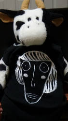 cow wearing a gorgeous luther shirt