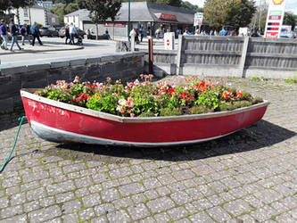 A Boat with Flowers.