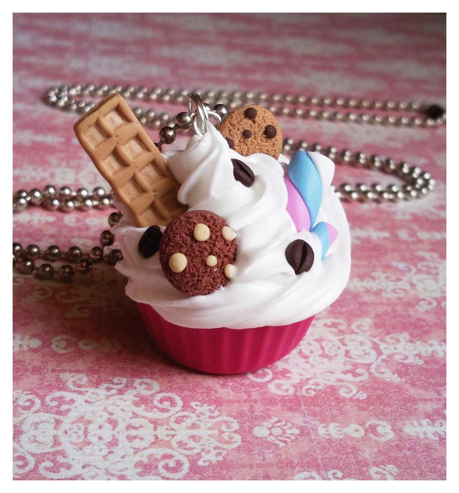 pink cupcake with candy by Miyaka89
