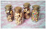 little bottles with cookies