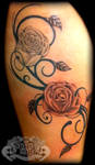 Roses and swirls on thigh by state-of-art-tattoo