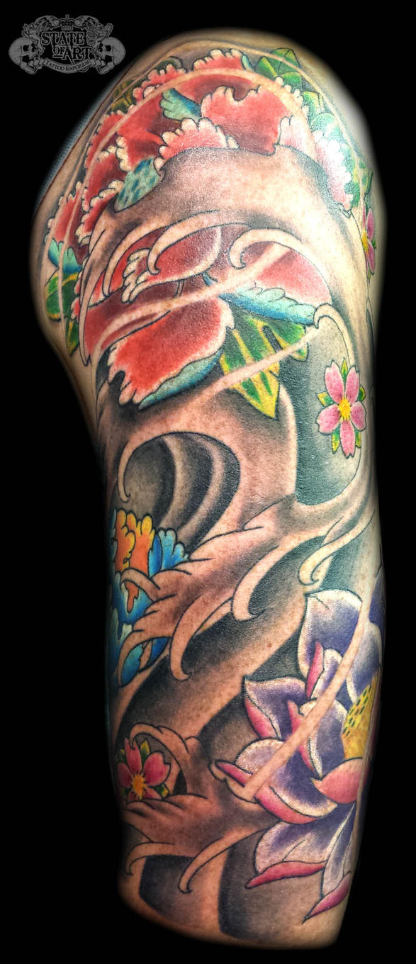 japanese waves and flowers by state of art tattoo on