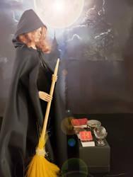 Larina prepares her altar