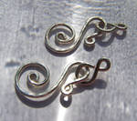 Handcrafted spiral clasps