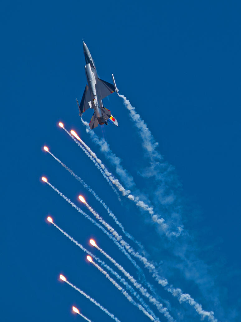 Belgian Air Component F16 with flares by davepphotographer