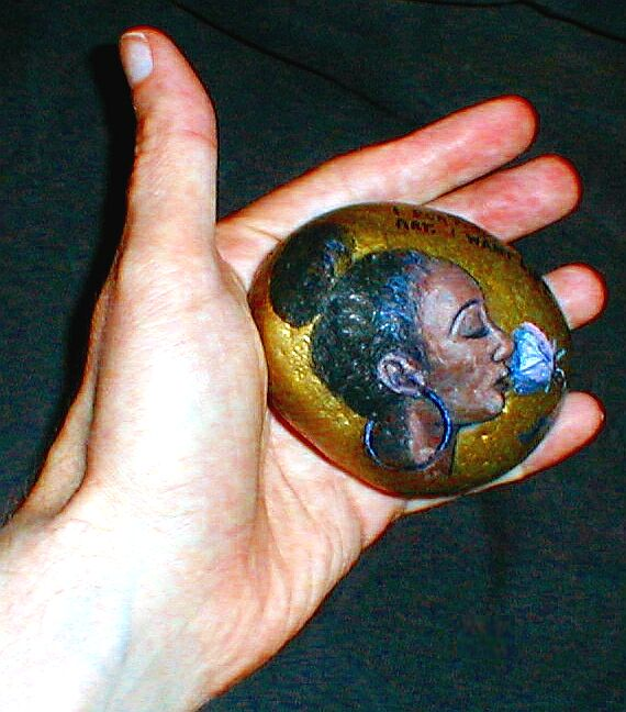 Painted Rock of a Woman Smelling a Flower by kramwartap