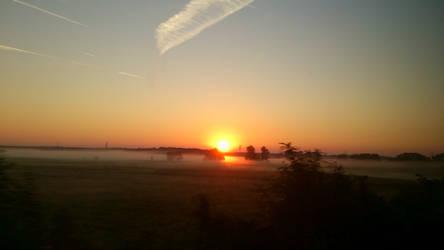 Misty sunset by darthsabe