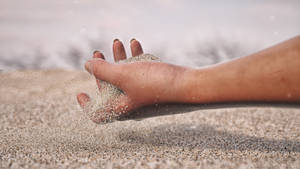 Sand hand