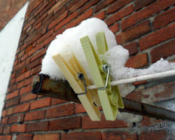 Meditation on two snowy clothespins by nadineleon