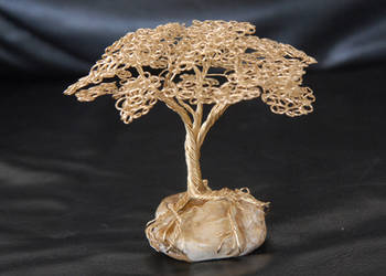 Wire tree sculpture on golden rough agate