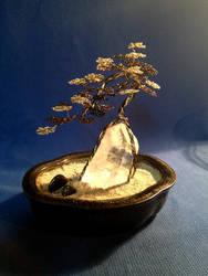 Cascade style wire bonsai tree on quartz crystal