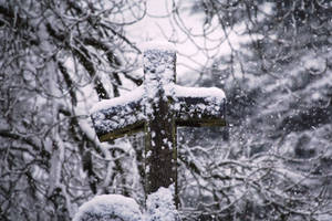 Snow-covered Wood Cross
