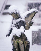 Snow-covered Angelic Memorial Statue