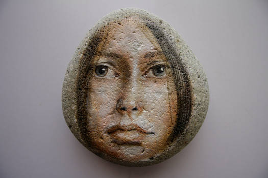 Girl painting on stone