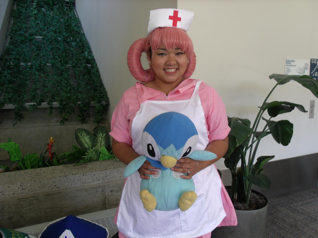 Nurse Joy and Piplup by Moogleborg