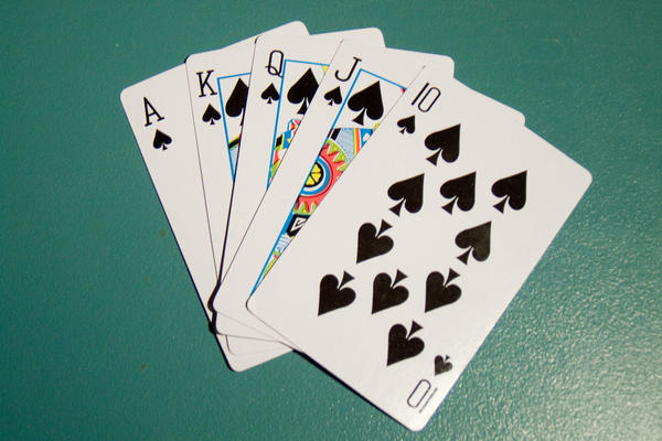 what is the probability of being dealt a spade or diamond flush