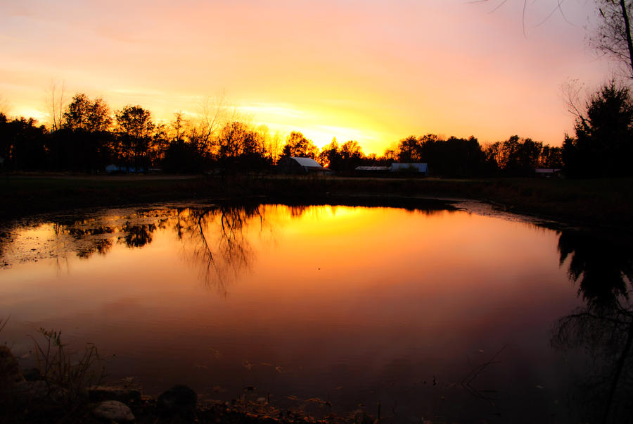 Pond at sunset by fixer