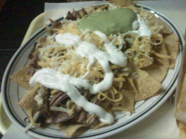 pulled pork nachos  by deviantgreed