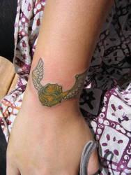 My first tattoo- golden snitch