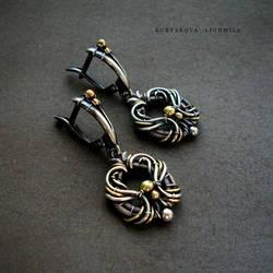 Silver/brass earring