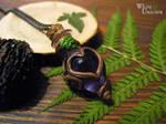 Purple 'potion' pendant