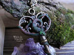 Two-sided enchanted key necklace by Ilvirin