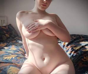 fully nude, enjoying the sun