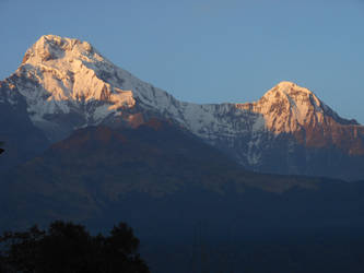 Snow capped mountains golden sunset
