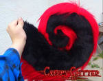 Black and red husky tail