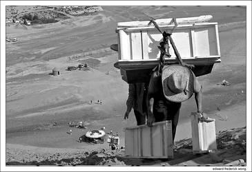 Mongolian Man Climbing Up Hill