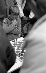 Kid playing chess by Reuno