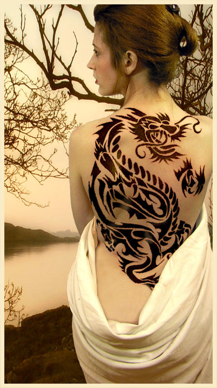 Japanese Girl With Dragon Tribal Tattoo On The Back Body By Offering