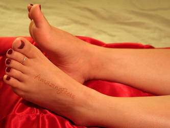 Perfectly Pedicured Feet on Satin