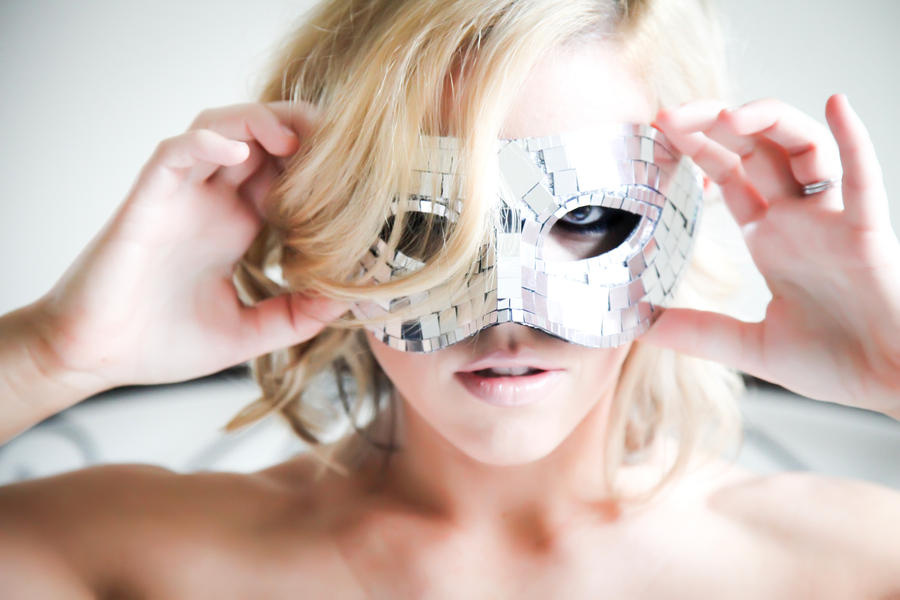 Masked Woman by SweetTradeStock