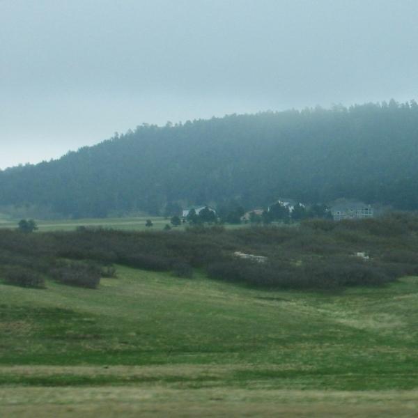 misty countryside by sataikasia