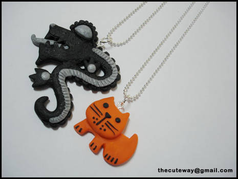 Clay necklaces cat and dragon