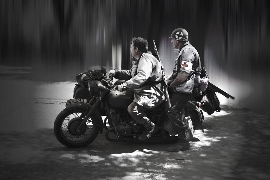 German and GI on motorcycle